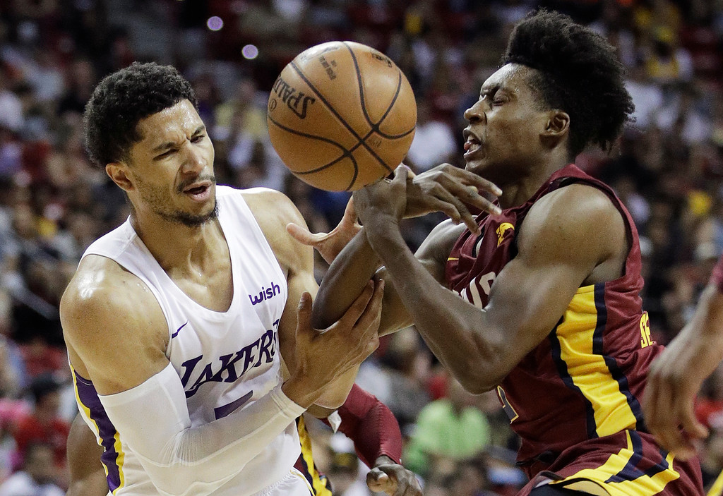 . Los Angeles Lakers\' Josh Hart, left, and Cleveland Cavaliers\' Collin Sexton battle for the ball during the second half of an NBA summer league basketball game, Monday, July 16, 2018, in Las Vegas. (AP Photo/John Locher)