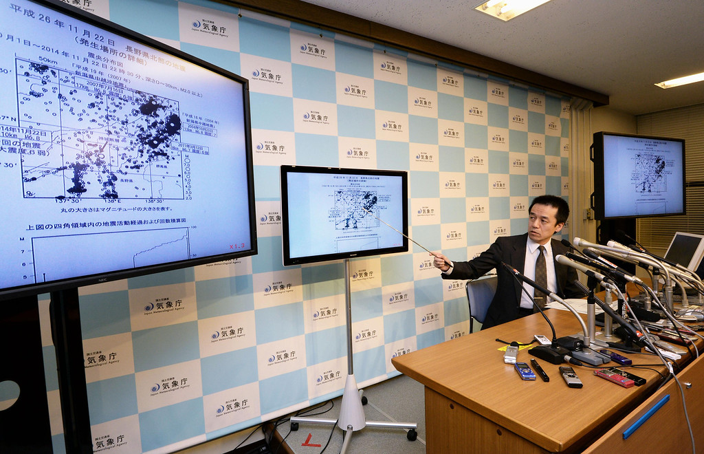 . Japan Meteorological Agency official Yohei Hasegawa speaks about a strong earthquake that struck a mountainous area of central Japan Saturday night, at the agency in Tokyo Sunday, Nov. 23, 2014. The magnitude-6.8 quake hit near Nagano city at 10:08 p.m. (1308 GMT) at a depth of 10 kilometers (6 miles). No tsunami warning was issued. (AP Photo/Kyodo News)