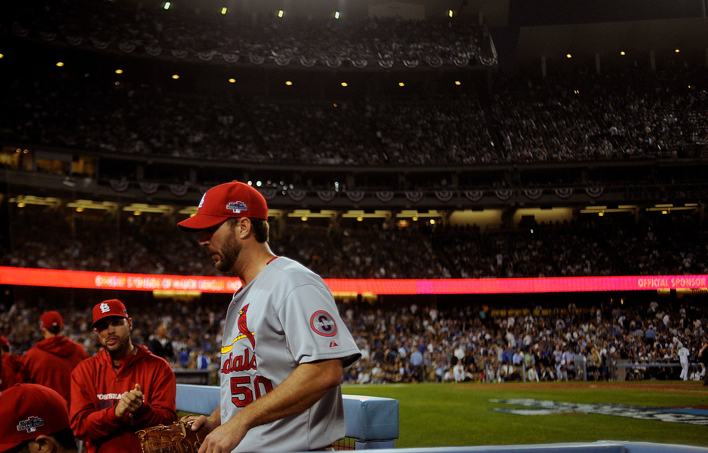 . Cardinals pitcher Adam Wainwright enters the dugout during game 3 of the NLCS at Dodger Stadium Monday, October 14, 2013. The Dodgers beat the Cardinals 3-0. (Photo by Hans Gutknecht/Los Angeles Daily News)