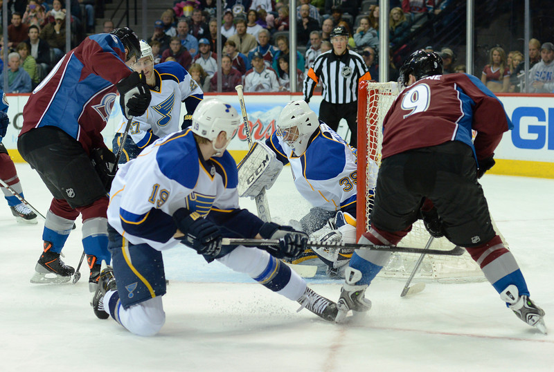 . Colorado center Matt Duchene (9) tried to feed Ryan O\'reilly (90) in front of the net in the first period. The St. Louis Blues defeated the Colorado Avalanche 2-1 at the Pepsi Center Saturday afternoon, March 8, 2014 in Denver, Colorado. (Photo by Karl Gehring/The Denver Post)