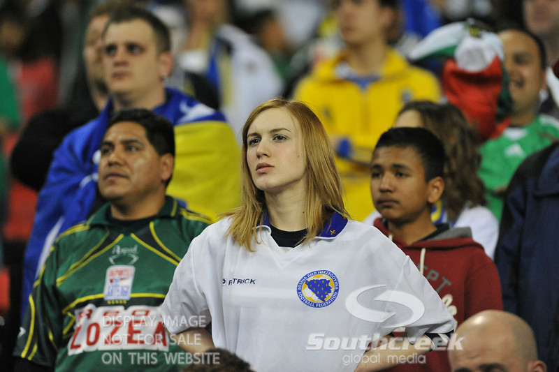 A Bosnia-Herzegovina fan looks on during Soccer action between Bosnia-Herzegovina and Mexico.  Mexico defeated Bosnia-Herzegovina 2-0 in the game at the Georgia Dome in Atlanta, GA.