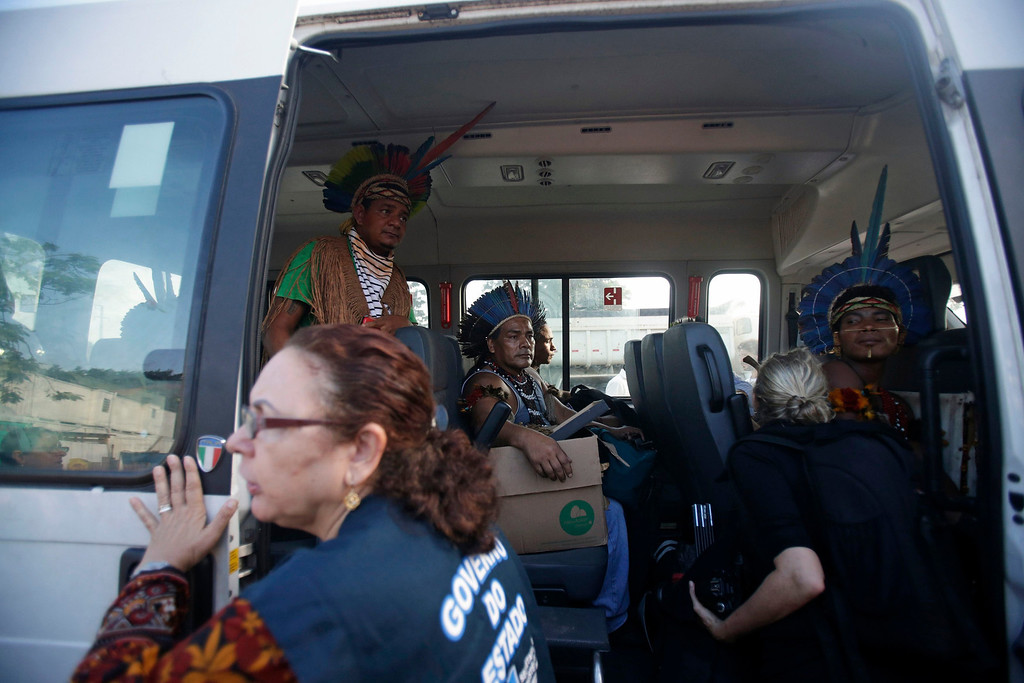 . Native Indians react inside a municipal vehicle after leaving the Brazilian Indian Museum, after a deal was made with authorities in Rio de Janeiro March 22, 2013. Brazilian military police took position early morning outside the Indian museum, where a native Indian community of around 30 individuals who have been living in the abandoned Indian Museum since 2006. Indians were summoned to leave the museum in 72 hours by court officials since last week, local media reported. The group is fighting against the destruction of the museum, which is next to the Maracana Stadium. Some Indians left, but several are still resisting. REUTERS/Ricardo Moraes
