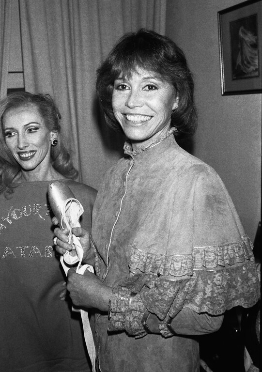 . Actress Mary Tyler Moore, a former dancer, joins ballerina Natalia Makarova backstage in New York, March 17, 1983, following a performance of the musical comedy ?on Your Toes,? in which Makarova is making her Broadway debut. The production is directed by 95-year-old George Abbott. (AP Photo/G. Paul Burnett)