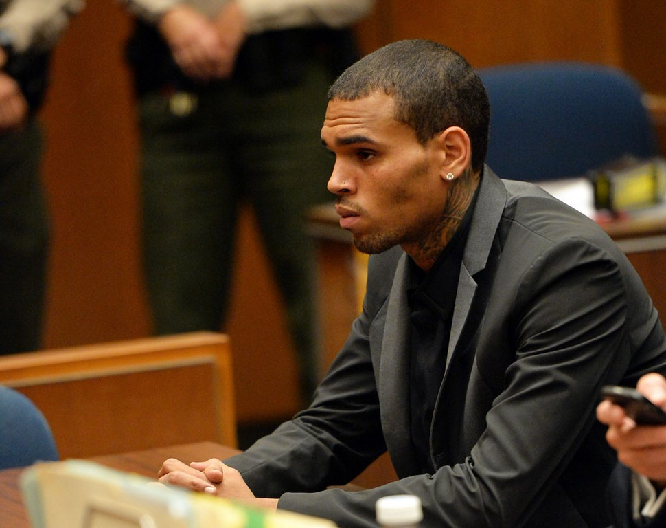 . <p>9. CHRIS BROWN  <p>Singer suffers seizure, probably caused by excessive slapping of women. (unranked) <p>    (AP Photo/Alberto E. Rodriguez, Pool)