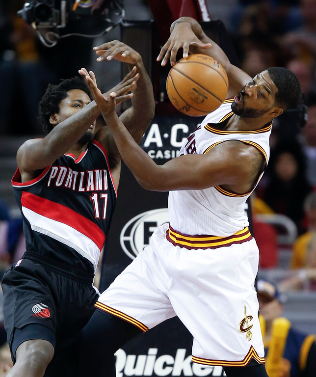 . Cleveland Cavaliers\' Tristan Thompson (13) grabs a rebound against Portland Trail Blazers\' Ed Davis (17) during the first half of an NBA basketball game Wednesday, Nov. 23, 2016, in Cleveland. (AP Photo/Ron Schwane)
