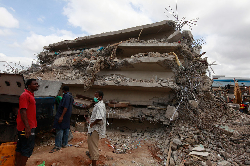 . In this photo taken on Saturday, Sept. 13, 2014, rescue workers search for survivors in the rubble of a collapsed building belonging to the Synagogue Church of All Nations in Lagos, Nigeria. Rescue workers have recovered 46 bodies and rescued 130 survivors from a collapsed shopping mall and guesthouse at the campus of renowned Nigerian preacher T.B. Joshua\'s Synagogue Church of All Nations, the West African nation\'s emergency agency said Monday, Sept. 15, 2014. (AP Photo/Sunday Alamba)