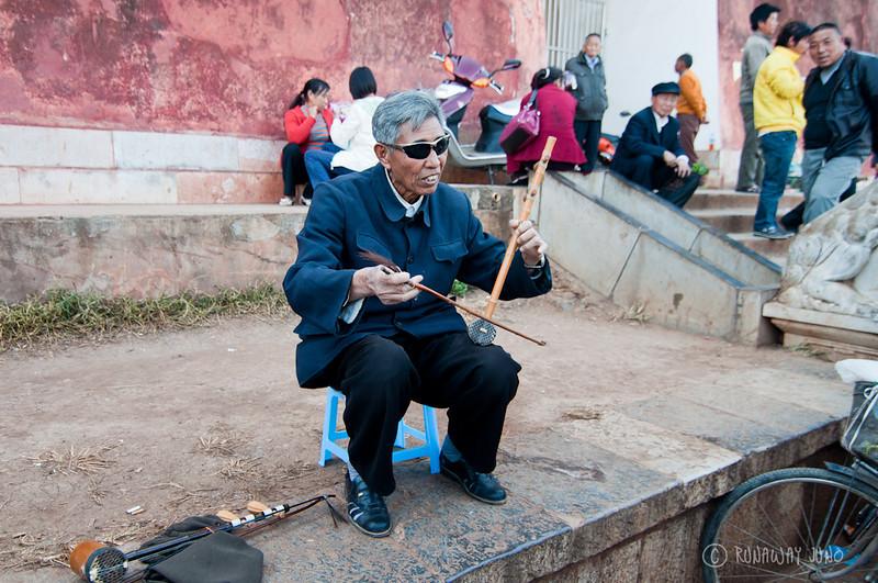 Playing musical instrument china.jpg