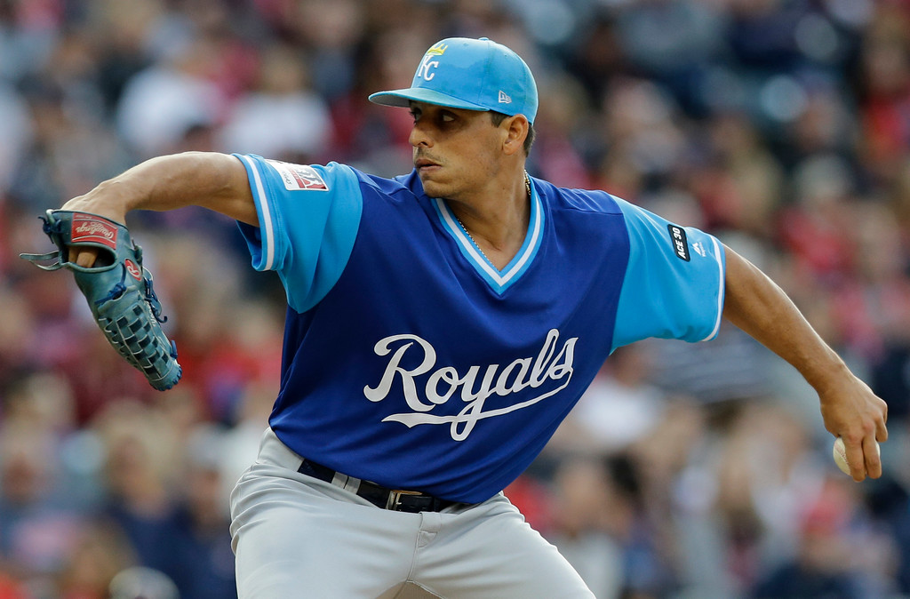 . Kansas City Royals starting pitcher Jason Vargas delivers in the first inning of a baseball game against the Cleveland Indians, Friday, Aug. 25, 2017, in Cleveland. (AP Photo/Tony Dejak)