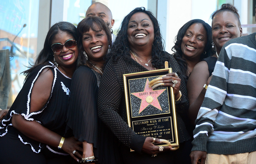 . The late Barry White\'s wife Glodean White (C) and family members pose following the unveiling of her husband\'s posthumous star along the Hollywood Walk of Fame on September 12, 2013. White, who died in 2003 and would have celebrated his birthday September 12, is most well known for his 1970\'s instrumental \'Love\'s Theme\' and is the recipient of the 2,506th Star in the category of recording.         (FREDERIC J. BROWN/AFP/Getty Images)