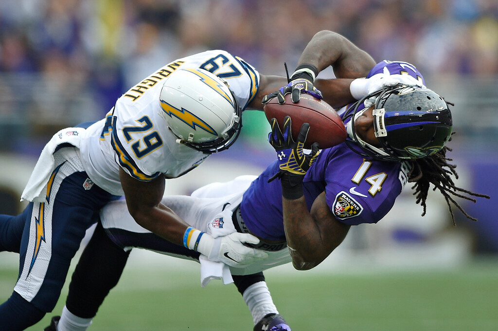 . Baltimore Ravens wide receiver Marlon Brown, right, makes a catch as he is tackled by San Diego Chargers cornerback Shareece Wright in the first half of an NFL football game, Sunday, Nov. 30, 2014, in Baltimore. (AP Photo/Nick Wass)