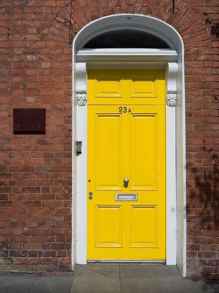 Closed yellow door of a house, Londonderry, Northern Ireland, Ireland
