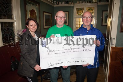 "Sabrina O'Hare and Pat Kearns present a cheque for £430 to Aiden Carroll from Macmillan Cancer Support the proceeds of Sheepbridge ""Stars in your Eyes"" which took place in October last year. Special thanks to Kieran Conlon who organised the event. R1608003"