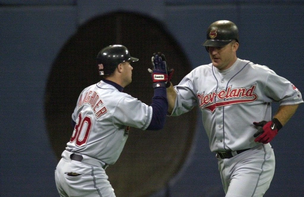 . Cleveland Indians Jim Thome high fives a third-base coach after hitting a solo home run off Minnesota Twins starting pitcher Eric Milton during the first inning in Minneapolis, Wednesday, June 5, 2002. The home run, was number 300 in Thome\'s career. (AP Photo/Eric Miller)
