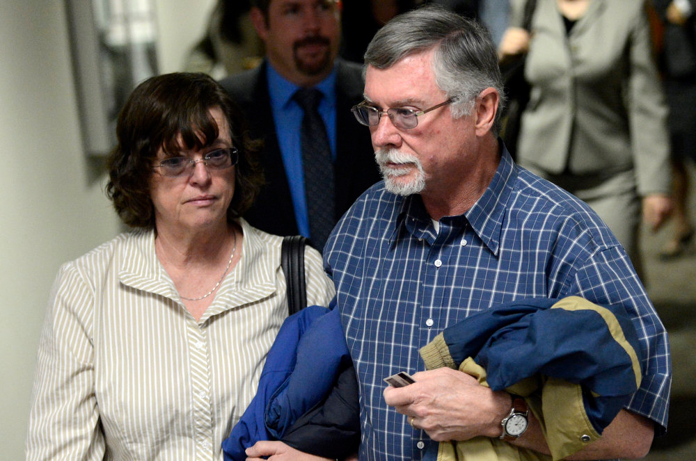 Description of . Parents Arlene and Robert Holmes, of Aurora theater shooting suspect James Holmes, arrive at court, Monday April 01, 2013. The prosecution will go for the death penalty against the Aurora theater shooting suspect James Holmes. (Photo By RJ Sangosti/The Denver Post)