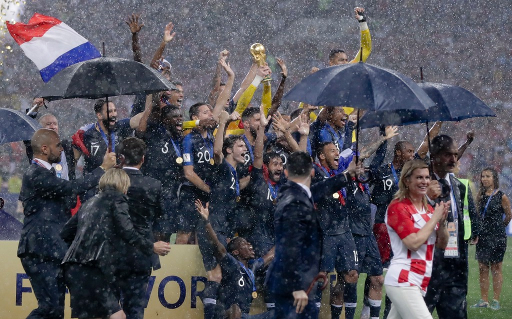 . France players hold up the World Cup trophy at the end of the final match between France and Croatia at the 2018 soccer World Cup in the Luzhniki Stadium in Moscow, Russia, Sunday, July 15, 2018. France won 4-2. (AP Photo/Petr David Josek)