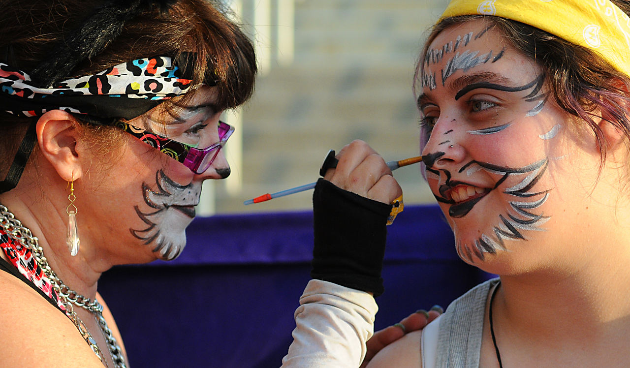 . Suzy McNamara, paints a Tara Madsen\'s, from Coon Rapids, face during the 2013 Internet Cat Video Festival presented by Walker Art Center at the Minnesota State Fair Grandstand, Wednesday, August 28, 2013 in Falcon Heights. (Pioneer Press: John Autey)