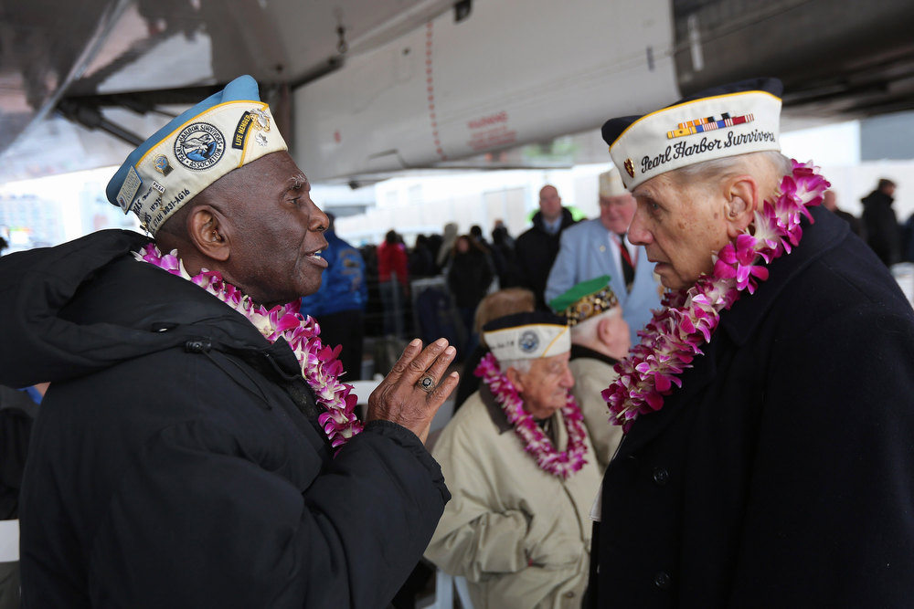 Description of . Pearl Harbor survivors Clark Simmons, 91, (L), and Aaron Chabin, 89, attend a ceremony commemorating the 71st anniversary of the Japanese attacks on Pearl Harbor on December 7, 2012 in New York City. World War II veterans from the New York metropolitan area participated in a wreath-laying ceremony next to the Intrepid Sea, Air and Space Museum, which was damaged in Hurricane Sandy and is undergoing repairs.  (Photo by John Moore/Getty Images)