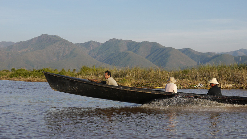 A man jets quickly across the lake at Inle Lake, Burma (Myanmar).