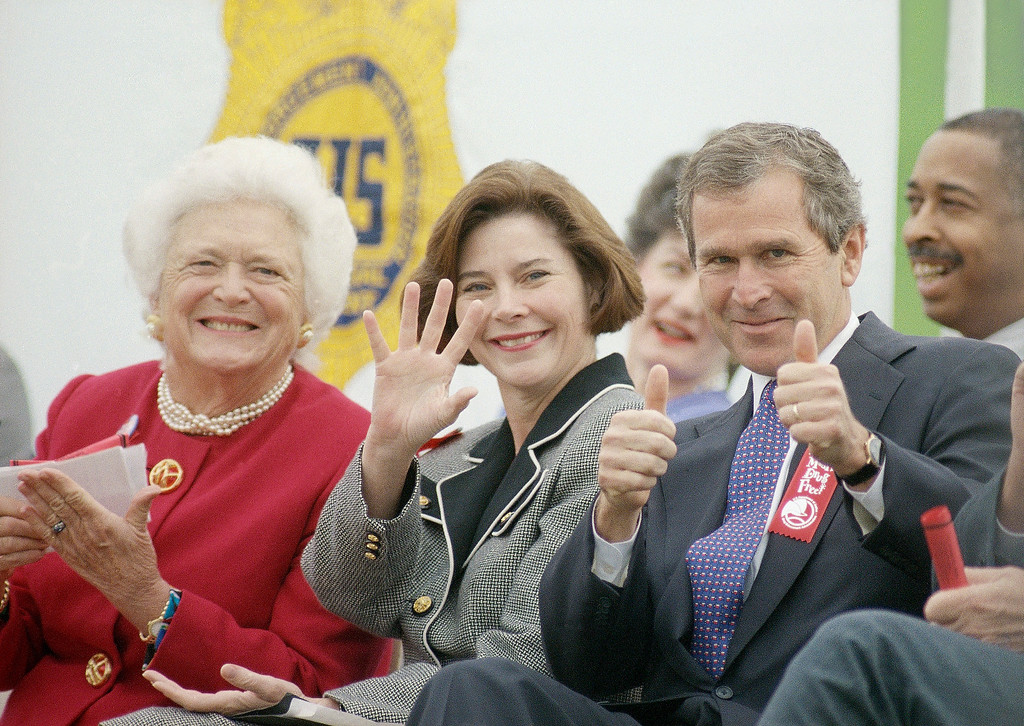 . Republican candidate for governor George W. Bush gives two thumbs up to the crowd as his wife Laura, and mother, former first lady Barbara Bush, join him on Thursday, Oct. 27, 1994 in Houston. They attended an anti-drug rally for students in the Spring Branch Independent School District.(AP Photo/David J. Phillip)
