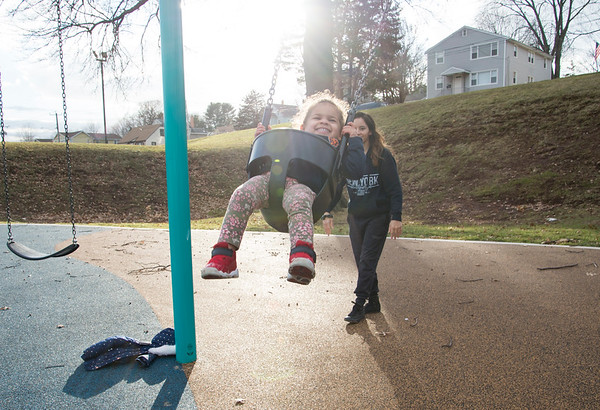 01/10/20 Wesley Bunnell | StaffrrKaishia Thompson pushes her daughter Evangelina, age 2, on the swings at Chesley Park on January 10th taking advantage of the mild weather.
