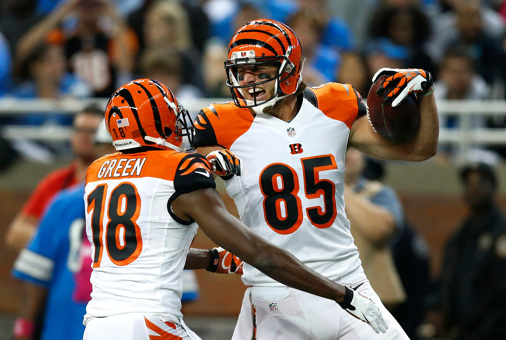 . Cincinnati Bengals\' Tyler Eifert (85) celebrates his 32-yard touchdown reception against the Detroit Lions with A.J. Green (18) in the third quarter of an NFL football game on Sunday, Oct. 20, 2013, in Detroit. (AP Photo/Rick Osentoski)