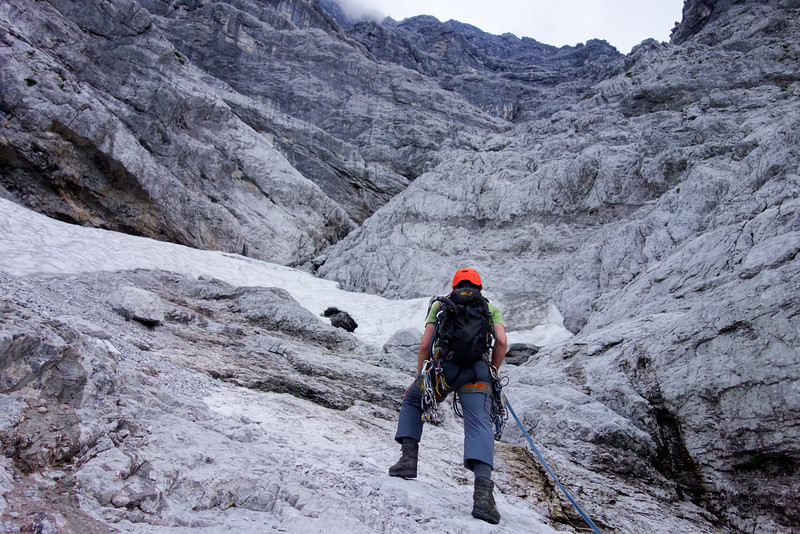 """At last! The end of the band of slabs, and we have reached """"Gipfelschlucht"""". Thanks to the snow field we can refill water to manage the night. It's almost 20.00, an hour before sunrise, and we have 400 vertical meters yet to climb."""