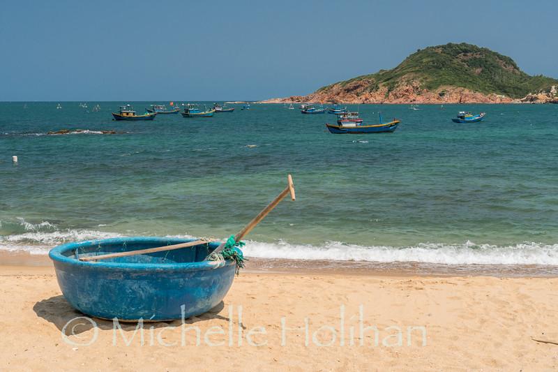Coracle and fishing boats, Bãi Rạng Beach, Quy Nhon, Vietnam