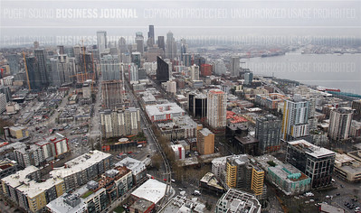 Pictured is the Seattle skyline looking Southwest from the roof of the Space Needle in Seattle, Wash. on Feb. 4, 2015. Part of the Elliott Bay waterfront is seen in the upper right.