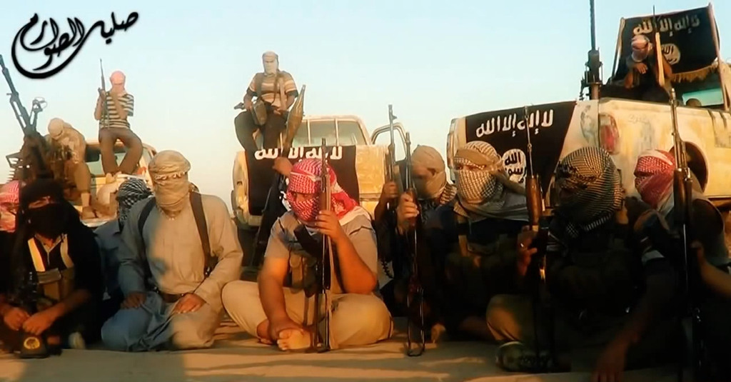 . An image grab taken from a propaganda video uploaded on June 8, 2014, by the jihadist group the Islamic State of Iraq and the Levant (ISIL) allegedly shows ISIL militants gathered near the central Iraqi city of Tikrit. Militants battled Iraqi security forces in Tikrit on June 11, 2014, after jihadists seized a swathe of the north, including second city Mosul, officials said. Heavy clashes rocked the north of Tikrit, hometown of now executed dictator Saddam Hussein, a provincial councillor said. AFP PHOTO / HO / ISIL (AFP/Getty Images)