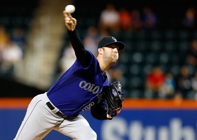 . Jordan Lyles #24 of the Colorado Rockies pitches in the first inning against the New York Mets at Citi Field on September 8, 2014 in the Flushing neighborhood of the Queens borough of New York City.  (Photo by Jim McIsaac/Getty Images)