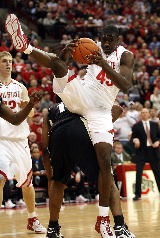 . Ohio State\'s Othello Hunter (45) grabs a rebound over Purdue\'s Carl Landry during the second half of a basketball game Saturday, Feb 10, 2007, in Columbus, Ohio. Ohio State\'s Matt Terwilliger, left, looks on. (AP Photo/Terry Gilliam)