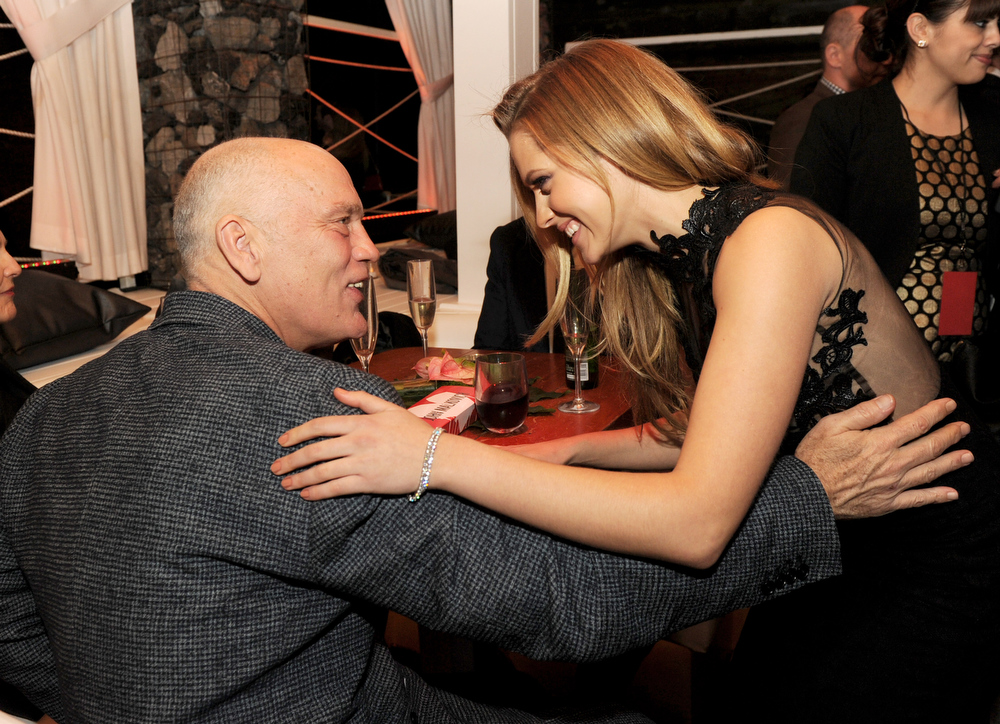 "Description of . Actors John Malkovich (L) and Teresa Palmer pose at the after party for the premiere of Summit Entertainment\'s ""Warm Bodies\"" at The Colony on January 29, 2013 in Los Angeles, California.  (Photo by Kevin Winter/Getty Images)"