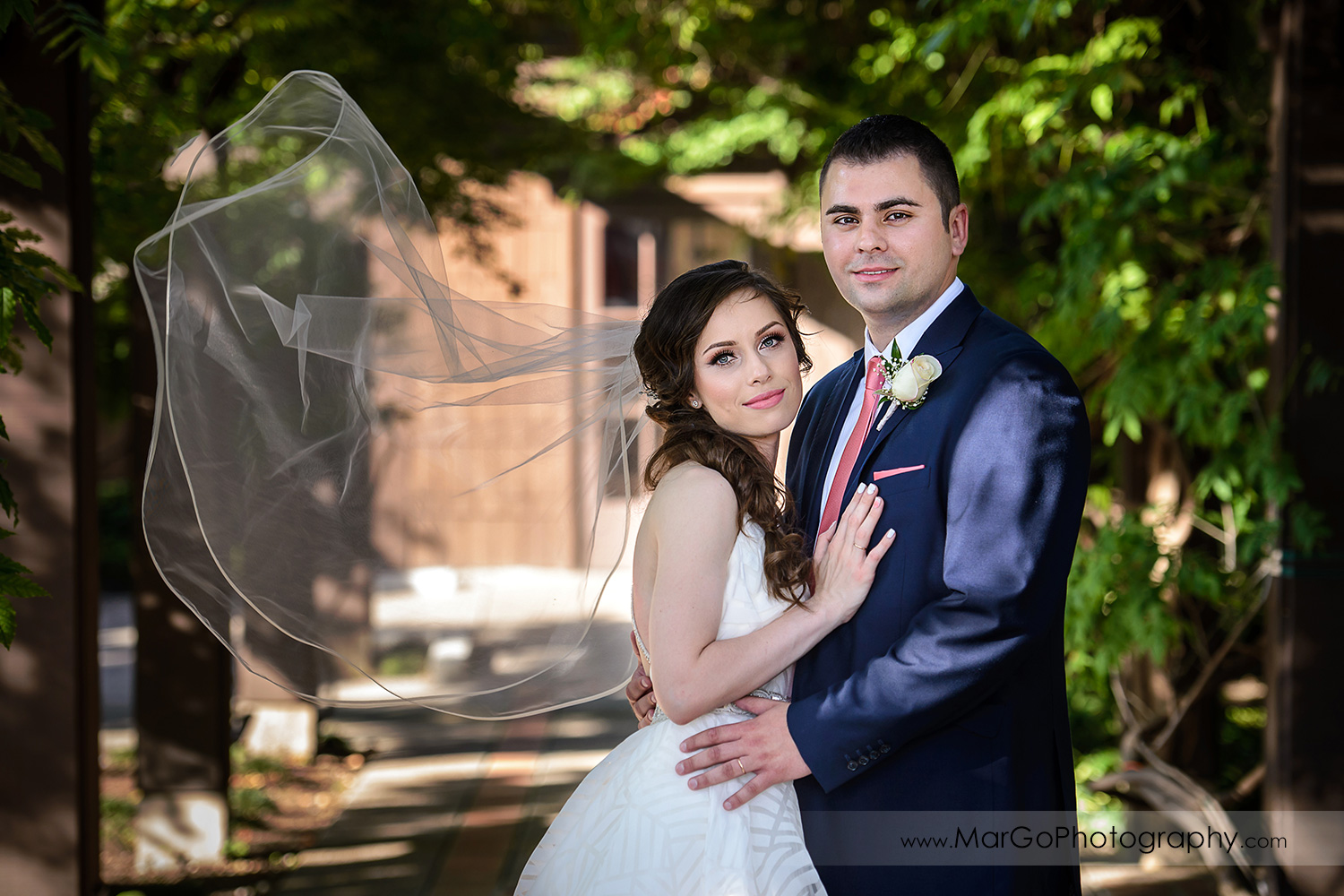 portrait of bride and groom with fluttering veil at Saratoga Foothill Club