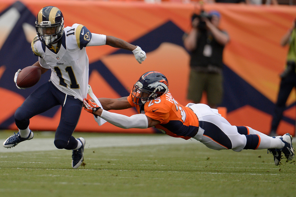 . DENVER, CO. - August 24: cornerback Chris Harris (25) of the Denver Broncos cannot tackle wide receiver Tavon Austin (11) of the St. Louis Rams during the first half of action. The Denver Broncos vs the St. Louis Rams during the 3rd pre-season game of the season at Sports Authority Field at Mile High. August 24, 2013 Denver, Colorado. (Photo By Joe Amon/The Denver Post)