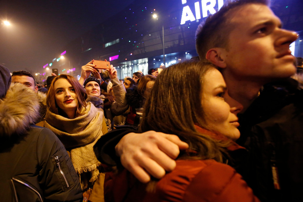 . Bosnian people watch fireworks during New Year\'s celebrations in downtown Sarajevo, Bosnia, Monday, Jan. 1, 2018. (AP Photo/Amel Emric)
