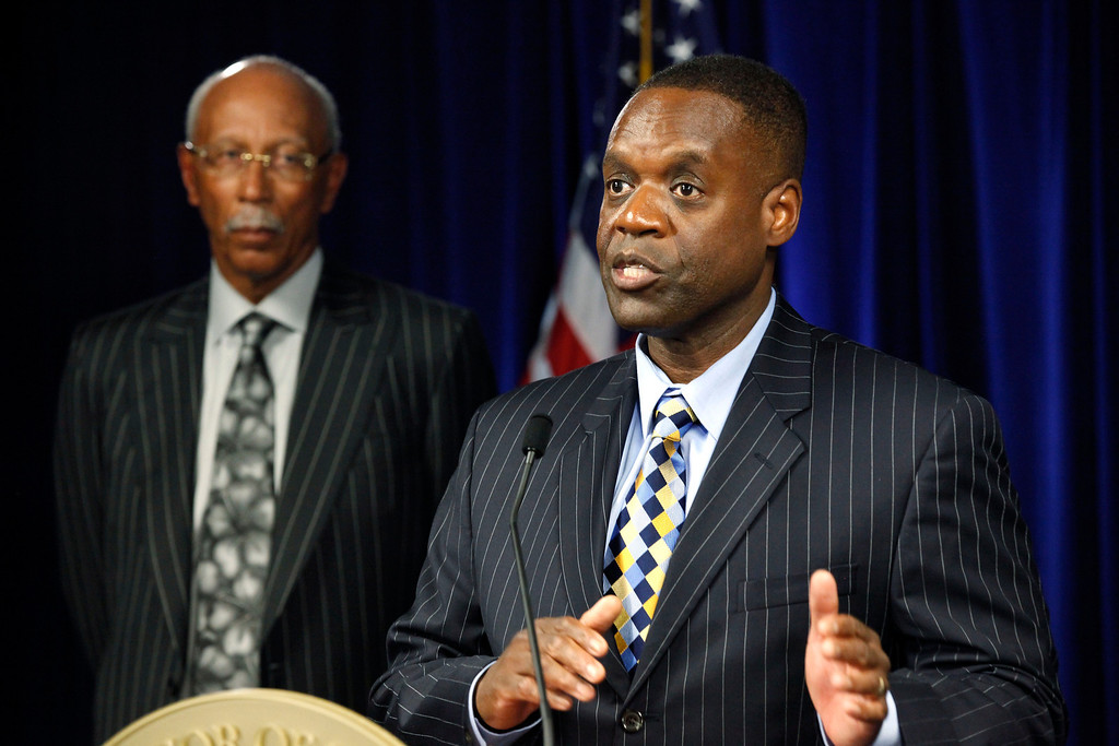 . State-appointed emergency manager Kevyn Orr, right, speaks as Detroit Mayor Dave Bing listens during a news conference in Detroit, Mich., Thursday, July 18, 2013. State-appointed emergency manager Kevyn Orr asked a federal judge permission to place Detroit into Chapter 9 bankruptcy protection Thursday. (AP Photo/Paul Sancya)