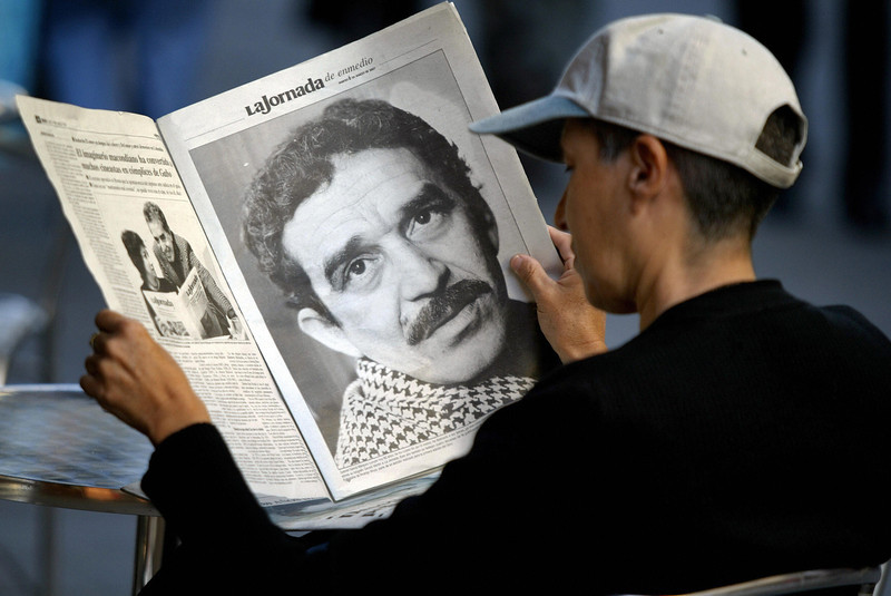. A young Mexican sitting in a cafe reads a newspaper which offers a special suplement dedicated to Colombian writer and Nobel Prize in Literature 1982 Gabriel Garcia Marquez in the day of his 80th anniversary, 06 March, 2007 in Mexico City.  AFP PHOTO/ Ronaldo SCHEMIDT (Photo credit should read Ronaldo Schemidt/AFP/Getty Images)