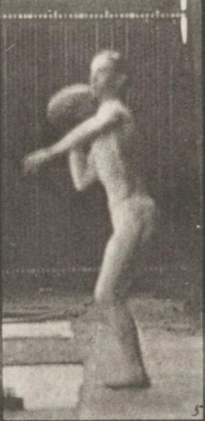 Man in pelvis cloth throwing rock