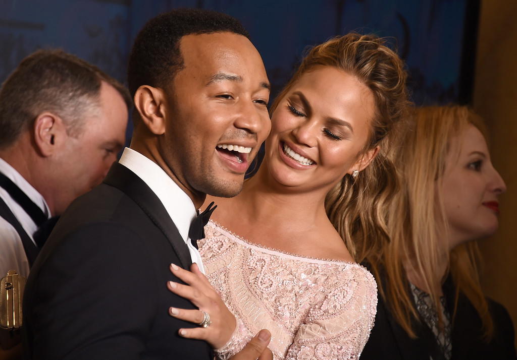 . John Legend, winner of the award for best original song ìGloryî in a film for ìSelmaî, poses with Chrissy Teigen, right, in the press room at the 72nd annual Golden Globe Awards at the Beverly Hilton Hotel on Sunday, Jan. 11, 2015, in Beverly Hills, Calif. (Photo by Jordan Strauss/Invision/AP)