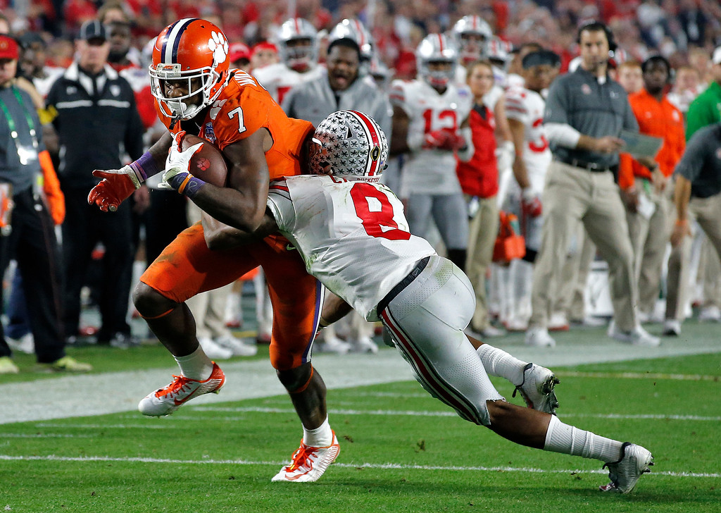 . Clemson wide receiver Mike Williams (7) is stopped by Ohio State cornerback Gareon Conley (8) during the second half of the Fiesta Bowl NCAA college football game, Saturday, Dec. 31, 2016, in Glendale, Ariz. (AP Photo/Ross D. Franklin)