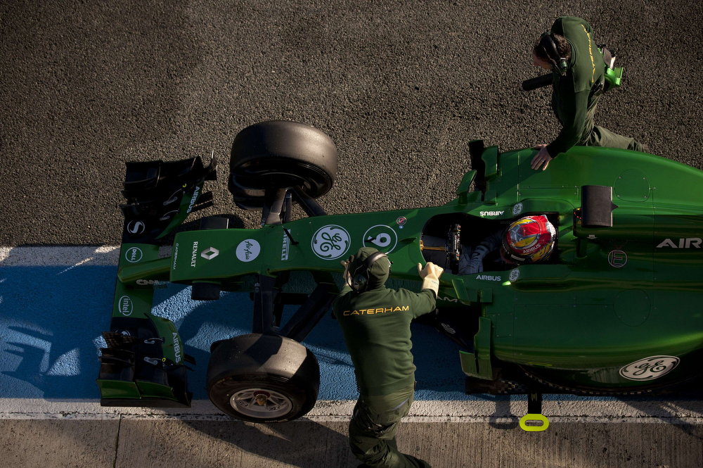 . Catherham F1 team\'s Dutch driver Robin Frijns is pushed in the pits during the Formula One pre-season test days at Jerez racetrack in Jerez on January 30, 2014. (Jorge Guerrero/AFP/Getty Images)
