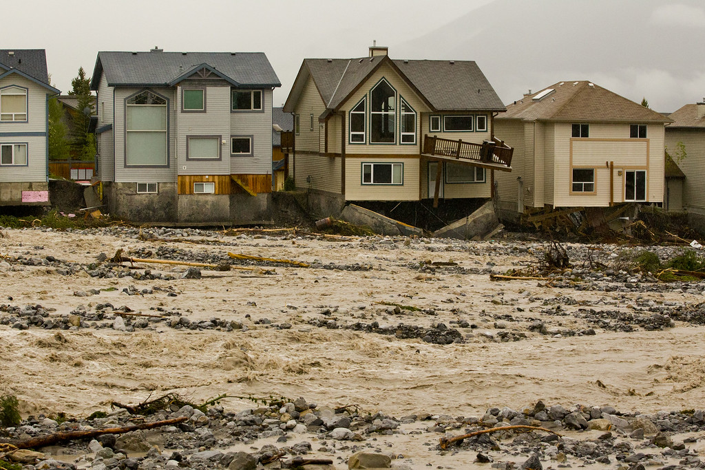 . Houses along Cougar Creek show extensive damage after heavy flooding June 21, 2013 in Canmore, Alberta, Canada. Widespread flooding caused by torrential rains washed out bridges and roads prompting the evacuation of thousands.  (Photo by John Gibson/Getty Images)