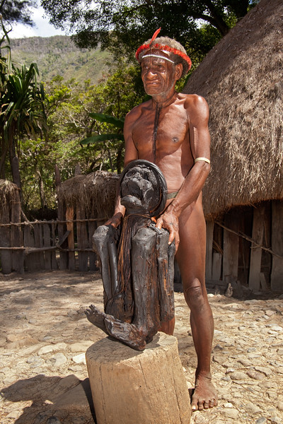 Exhibiting the mummy of a former chief of the Dani people in West Papua, New Guinea. At the time of this photo in 2013, the mummy was 369 years old. The chief had left instructions to preserve his body. It is brought out of the men's house only briefly for visitors to see.