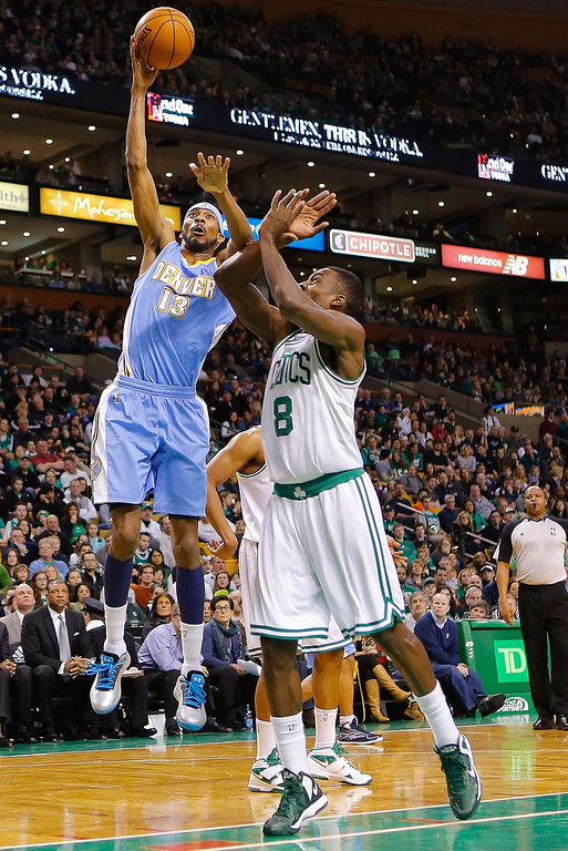 . BOSTON, MA - FEBRUARY 10: Corey Brewer #13 of the Denver Nuggets takes a shot over Jeff Green #8 of the Boston Celtics during the game on February 10, 2013 at TD Garden in Boston, Massachusetts.  (Photo by Jared Wickerham/Getty Images)