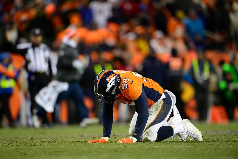 . Denver Broncos outside linebacker Von Miller (58) is slow to get up after a play in the fourth quarter. The Denver Broncos vs Baltimore Ravens AFC Divisional playoff game at Sports Authority Field Saturday January 12, 2013. (Photo by AAron  Ontiveroz,/The Denver Post)