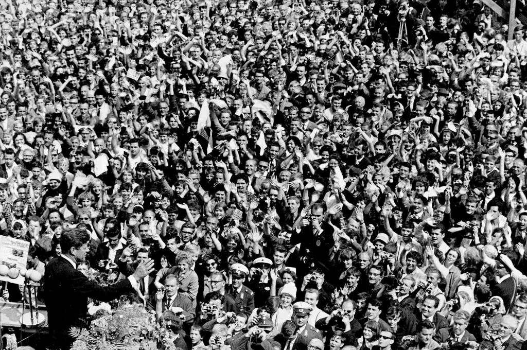 """. Kennedy, left, waves to a crowd of more than 300,000 gathered to hear his speech where he declared, \""""Ich bin ein Berliner\"""" (\""""I am a Berliner\"""") in the main square in front of Schoeneberg City Hall in West Berlin on June 26, 1963. Associated Press file"""