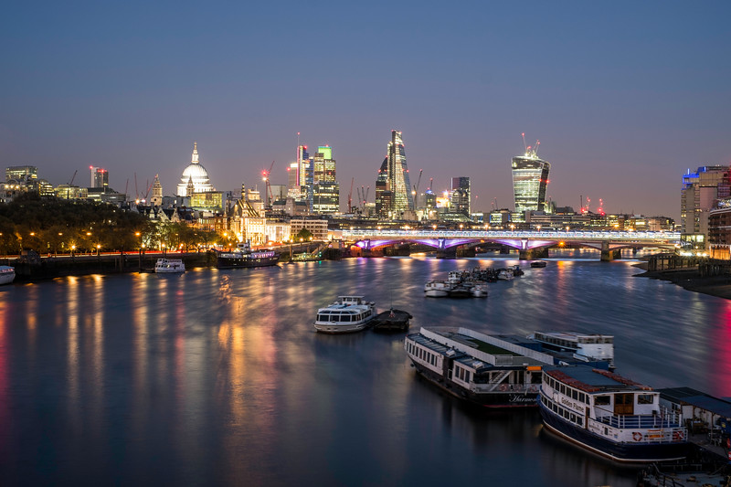 Night view of Thames River and City of London, United Kingdom