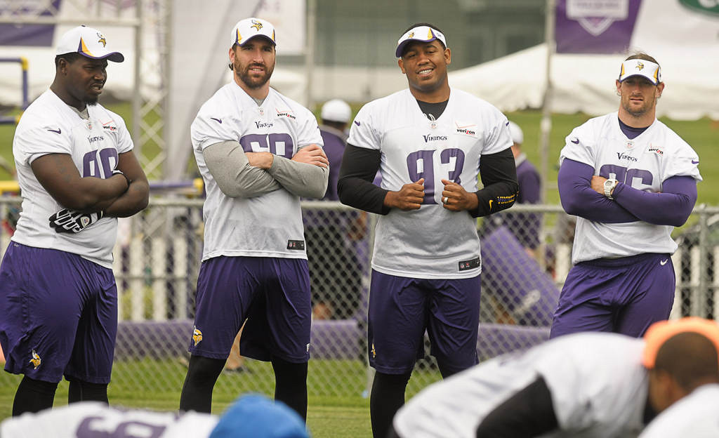 . From left, defensive tackle Letroy Guion, defensive end Jared Allen, defensive tackle Kevin Williams and defensive end Brian Robison watch during training camp Friday. (Pioneer Press: Ben Garvin)