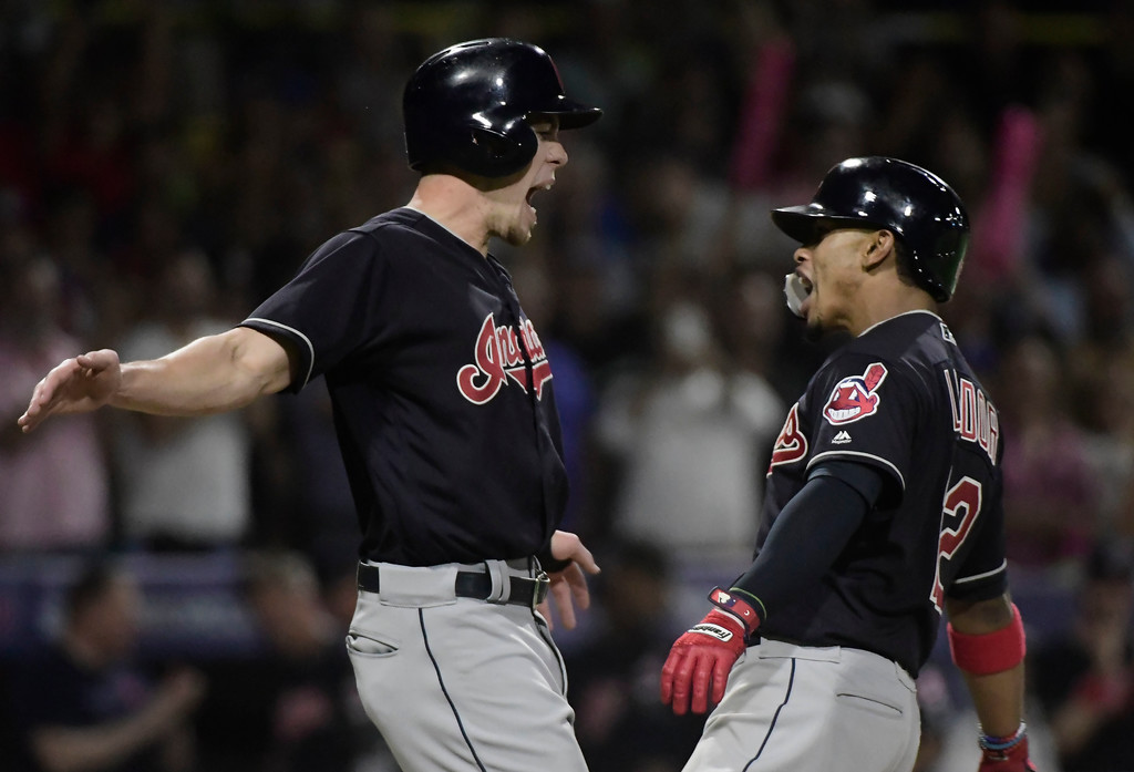 . CORRECTS RIVAL TEAM TO MINNESOTA TWINS - Cleveland Indians\' infielder Francisco Lindor, right, celebrates a home run with outfielder Bradley Zimmer during the fifth inning of game one of a two-game MLB Series against the Minnesota Twins at Hiram Bithorn Stadium in San Juan, Puerto Rico, Tuesday, April 17, 2018. (AP Photo/Carlos Giusti)
