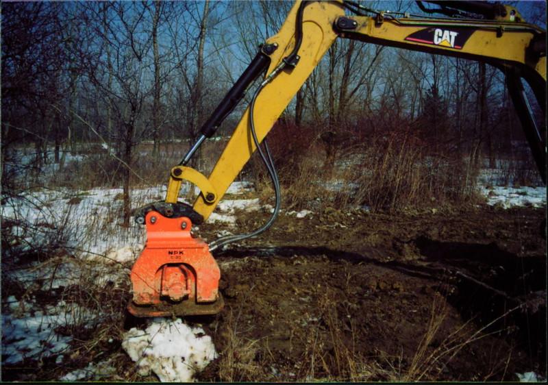 NPK C2D compactor on Cat mini excavator (13).JPG